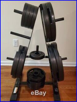 OLYMPIC BENCH PRESS With BAR AND 365 POUNDS OF CAP WEIGHTS AND STAND